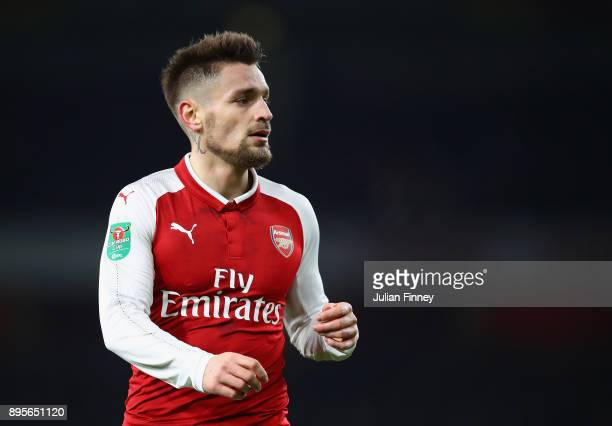 Mathieu Debuchy of Arsenal looks on during the Carabao Cup Quarter Finals match between Arsenal and West Ham United at Emirates Stadium on December...