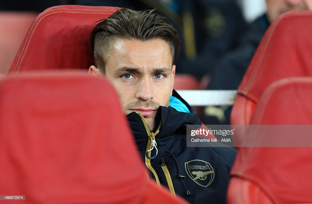 Mathieu Debuchy of Arsenal on the bench before the UEFA Champions League match between Arsenal and Olympiacos at the Emirates Stadium on September 29, 2015 in London, United Kingdom.