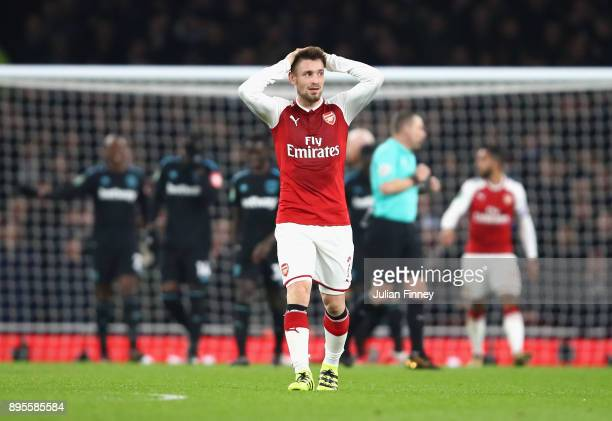 Mathieu Debuchy of Arsenal reacts during the Carabao Cup Quarter-Final match between Arsenal and West Ham United at Emirates Stadium on December 19,...