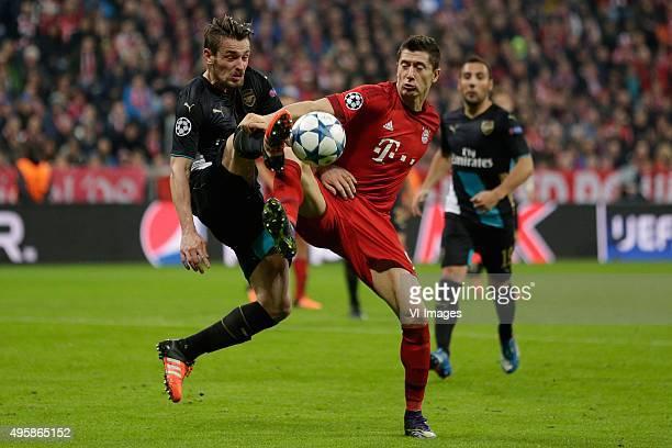 Mathieu Debuchy of Arsenal Robert Lewandowski of Bayern Munchen during the Champion League group F match between FC Bayern Munich and Arsenal FC on...