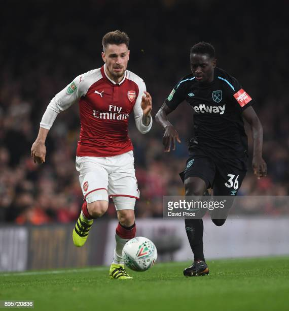 Mathieu Debuchy of Arsenal takes on Domingos Quina of West Ham during the Carabao Cup Quarter Final match between Arsenal and West Ham United at...