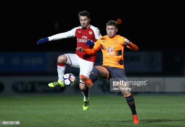 Mathieu Debuchy of Arsenal wins the ball off of Josh Barrett of Reading during the Premier League International Cup match between Arsenal and Reading...