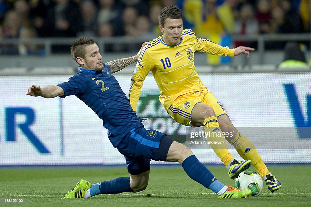 Mathieu Debuchy (L) of France fights for the ball with Ukraine's Yevhen Konoplyanka (R) during the FIFA 2014 World Cup Qualifier Play-off First Leg soccer match between Ukraine and France at the Olympic Stadium on November 15, 2013 in Kiev, Ukraine.