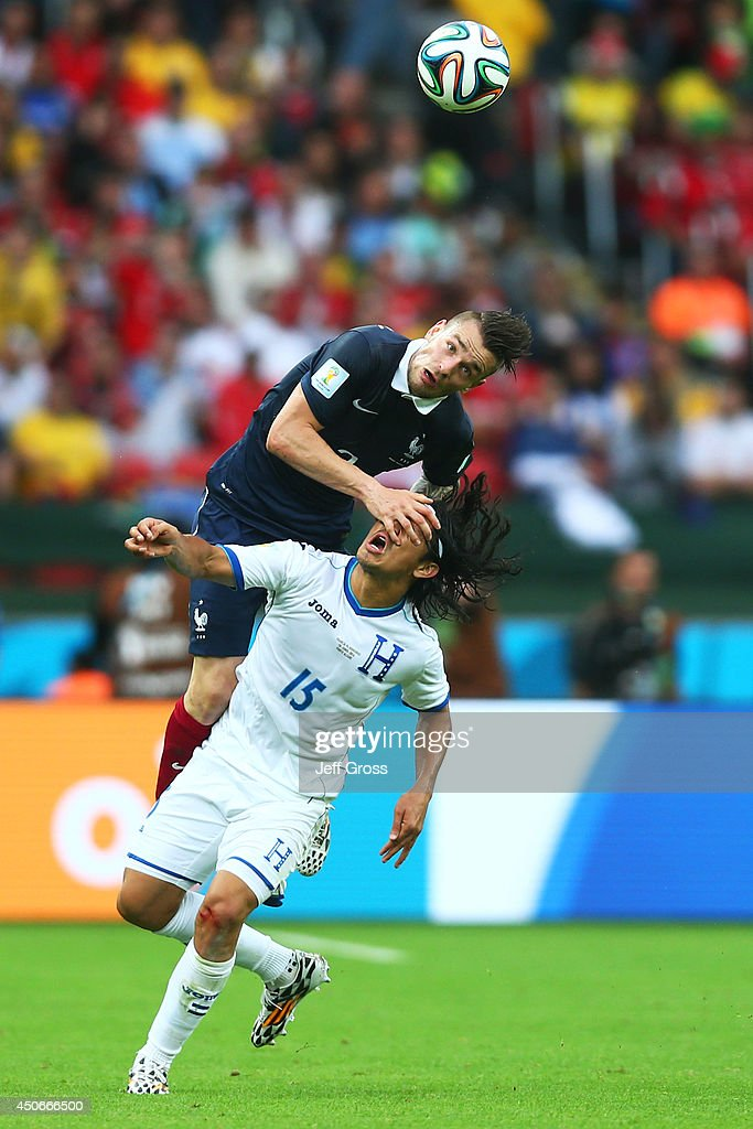 Mathieu Debuchy of France goes up for a header against Roger Espinoza of Honduras during the 2014 FIFA World Cup Brazil Group E match between France and Honduras at Estadio Beira-Rio on June 15, 2014 in Porto Alegre, Brazil.