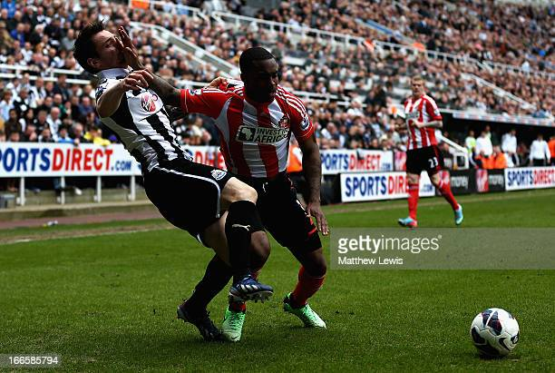 Mathieu Debuchy of Newcastle and Danny Rose of Sunderland challenge for the ball during the Barclays Premier League match between Newcastle United...