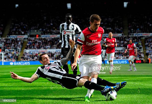 Mathieu Debuchy of Newcastle in action against Aaron Ramsey of Arsenal during the Barclays Premier League match between Newcastle United and Arsenal...