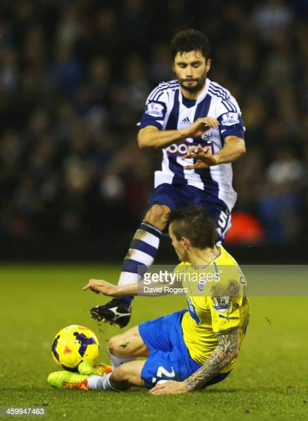 Mathieu Debuchy of Newcastle United challenges Claudio Yacob of West Bromwich Albion a tackle leading to his sending off during the Barclays Premier...