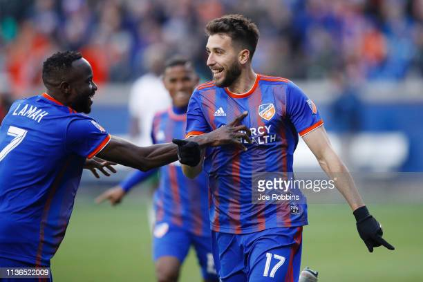 Mathieu Deplagne and Roland Lamah of FC Cincinnati celebrate after a goal against the Portland Timbers in the second half at Nippert Stadium on March...