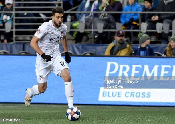 Mathieu Deplagne of FC Cincinnati brings the ball up the the pitch during the second half of the match against the the Seattle Sounders at...