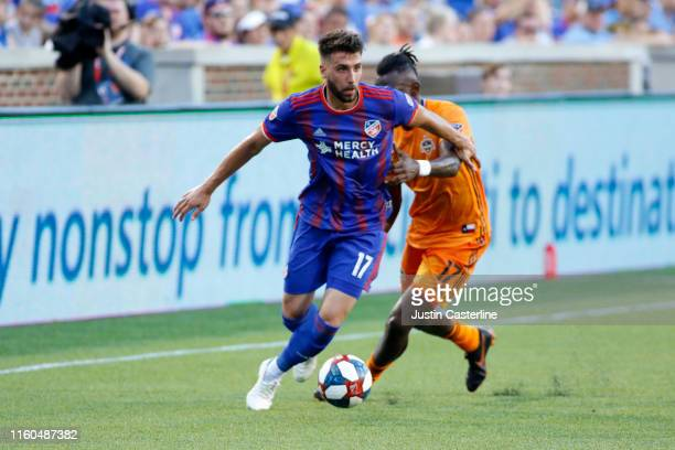 Mathieu Deplagne of FC Cincinnati controls the ball against Alberth Elis of Houston Dynamo at Nippert Stadium on July 06 2019 in Cincinnati Ohio