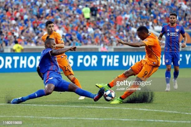 Mathieu Deplagne of FC Cincinnati tackles Mauro Manotas of Houston Dynamo at Nippert Stadium on July 06 2019 in Cincinnati Ohio