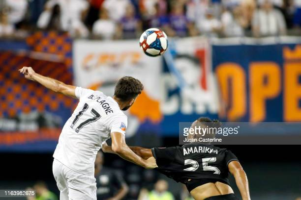 Mathieu Deplagne of the FC Cincinnati heads the ball while being defended by Quincy Amarikwa of the D.C. United at Nippert Stadium on July 18, 2019...