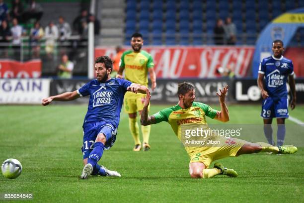 Mathieu Deplagne of Troyes and Emiliano Sala of Nantes during the Ligue 1 match between Troyes Estac and FC Nantes at Stade de l'Aube on August 19...
