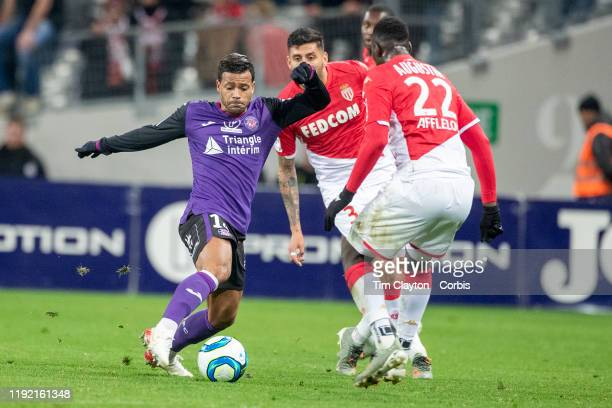 Mathieu Dossevi of Toulouse defended by JeanKevin Augustin of Monaco during the Toulouse FC V AS Monaco French Ligue 1 regular season match at the...