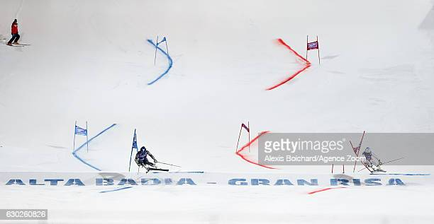 Mathieu Faivre of France Gino Caviezel of Switzerland compete during the Audi FIS Alpine Ski World Cup Men's Parallel Giant Slalom on December 19...
