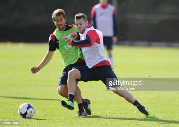 Mathieu Flamini and Jack Wilshere of Arsenal during a training session at London Colney on October 25, 2013 in St Albans, England.