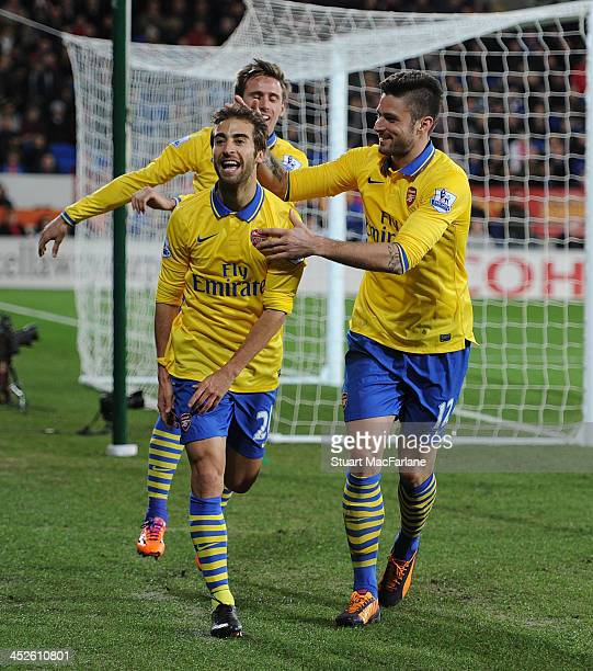 Mathieu Flamini celebrates scoring the 2nd Arsenal goal with Olivier Giroud during the match at Cardiff City Stadium on November 30 2013 in Cardiff...