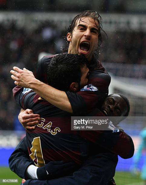 Mathieu Flamini Cesc Fabregas and Emmanuel Eboue of Arsenal celebrate the own goal scored by Jlloyd Samuel of Bolton during the Barclays Premiership...
