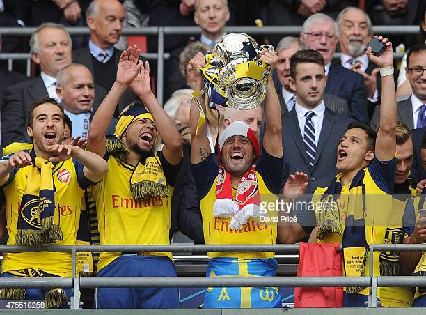 Mathieu Flamini Francis Coquelin Santi Cazorla and Alexis Sanchez with the FA Cup Trophy after the match between Arsenal and Aston Villa in the FA...