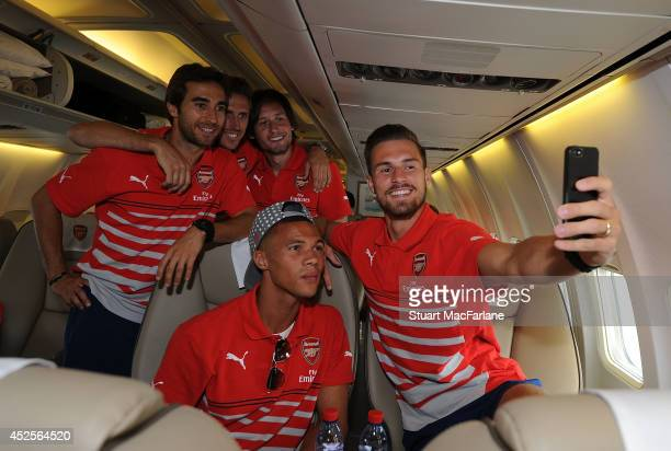 Mathieu Flamini, Nacho Monreal, Tomas Rosicky, Kieran Gibbs and Aaron Ramsey of Arsenal at Luton Airport on July 23, 2014 in Luton, England.