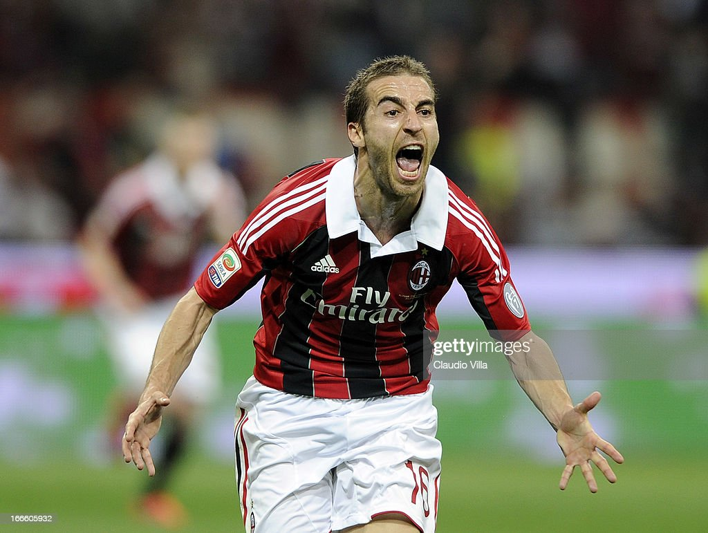 Mathieu Flamini of AC Milan celebrates scoring the first goal during the Serie A match between AC Milan and SSC Napoli at San Siro Stadium on April 14, 2013 in Milan, Italy.