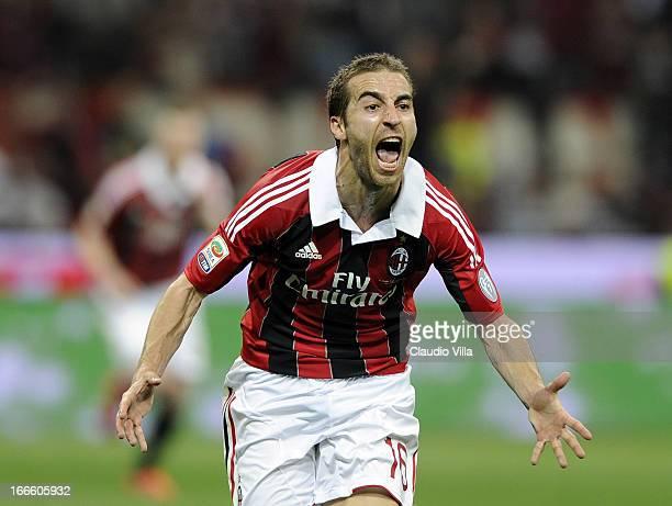 Mathieu Flamini of AC Milan celebrates scoring the first goal during the Serie A match between AC Milan and SSC Napoli at San Siro Stadium on April...