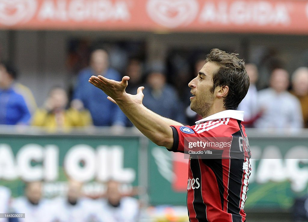 Mathieu Flamini of AC Milan celebrates scoring their first goal during the Serie A match between AC Milan and Novara Calcio at Stadio Giuseppe Meazza on May 13, 2012 in Milan, Italy.