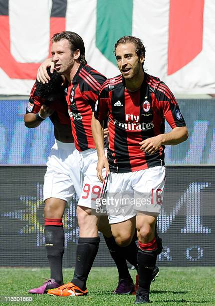 Mathieu Flamini of AC Milan celebrates with teammates after scoring the opening goal of the Serie A match between AC Milan and Bologna FC at Stadio...