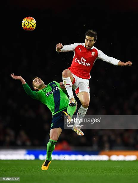 Mathieu Flamini of Arsenal and Dusan Tadic of Southampton compete for the ball during the Barclays Premier League match between Arsenal and...