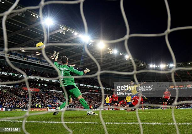 Mathieu Flamini of Arsenal beats goalkeeper David Marshall of Cardiff City as he scores their second goal during the Barclays Premier League match...