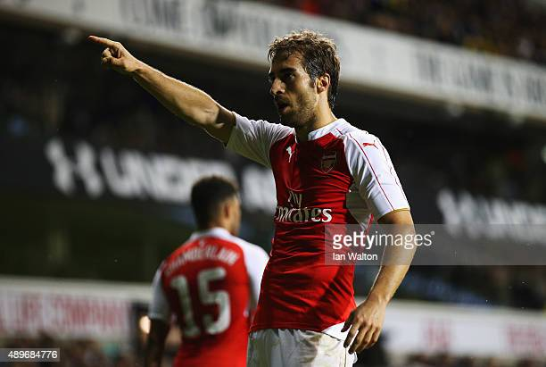 Mathieu Flamini of Arsenal celebrates as he scores their second goal during the Capital One Cup third round match between Tottenham Hotspur and...