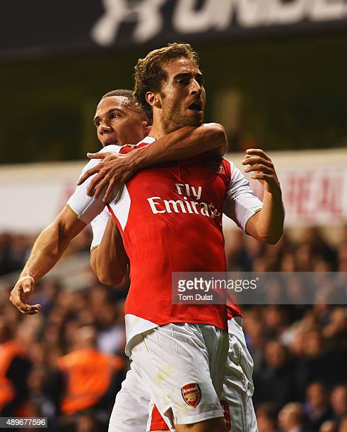 Mathieu Flamini of Arsenal celebrates with Kieran Gibbs as he scores their first goal during the Capital One Cup third round match between Tottenham...