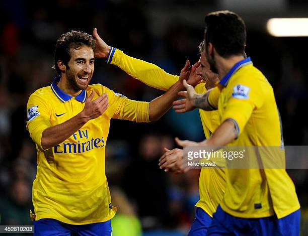 Mathieu Flamini of Arsenal celebrates with Olivier Giroud and Nacho Monreal as he scores their second goal during the Barclays Premier League match...