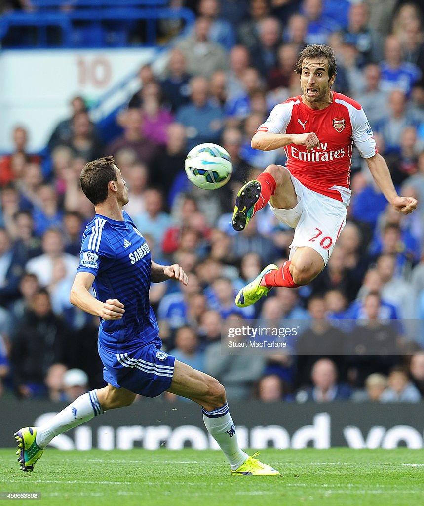 Mathieu Flamini of Arsenal challenged Nemanja Matic of Chelsea during the Barclays Premier League match between Chelsea and Arsenal at Stamford Bridge on October 5, 2014 in London, England.