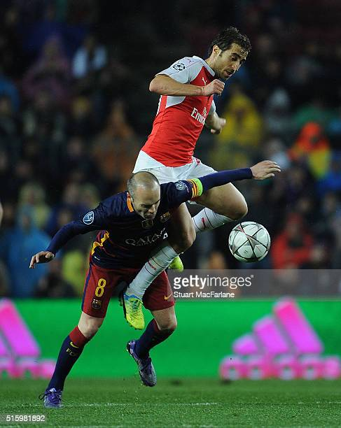 Mathieu Flamini of Arsenal challenges Andres Inesta of Barcelona during the UEFA Champions League Round of 16 2nd Leg match between Barcelona and...