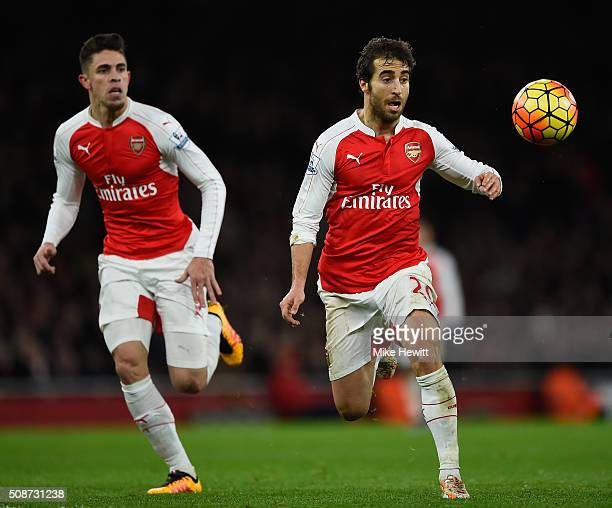 Mathieu Flamini of Arsenal is supported by team mate Gabriel during the Barclays Premier League match between Arsenal and Southampton at the Emirates...