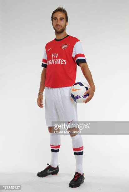 Mathieu Flamini of Arsenal poses during a portrait shoot as he is unveiled as a new signing at Emirates Stadium on August 28 2013 in London England