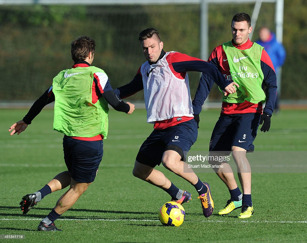 Mathieu Flamini, Olivier Giroud and Thomas Vermaelen of Arsenal during a training session at London Colney on November 22, 2013 in St Albans, England.