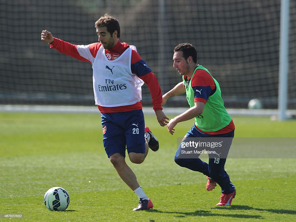 Mathieu Flaminio and Santi Cazorla of Arsenal during a training session at London Colney on March 20, 2015 in St Albans, England.