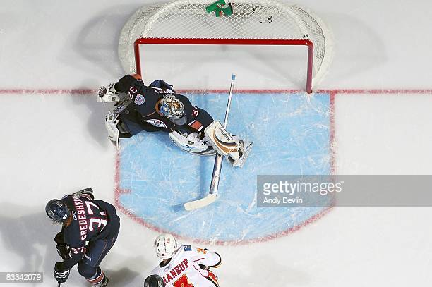 Mathieu Garon of the Edmonton Oilers lets in a first period goal against the Calgary Flames during a game on October 18 2008 at Rexall Place in...