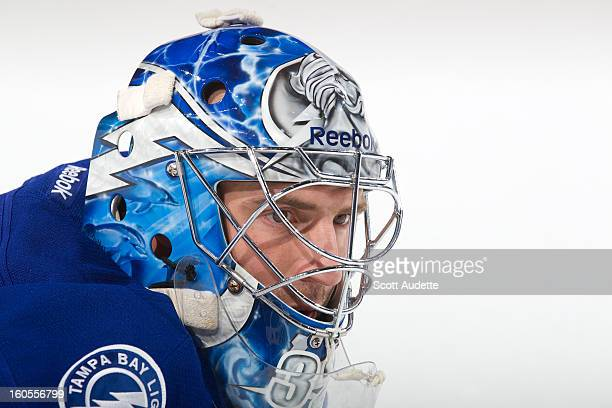 Mathieu Garon of the Tampa Bay Lightning warms up prior to the start of the game against the New York Rangers at the Tampa Bay Times Forum on...