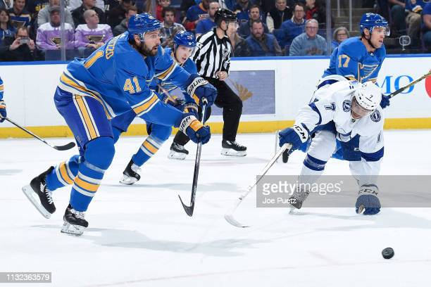 Mathieu Joseph of the Tampa Bay Lightning attempts to block a shot form Robert Bortuzzo of the St Louis Blues at Enterprise Center on March 23 2019...