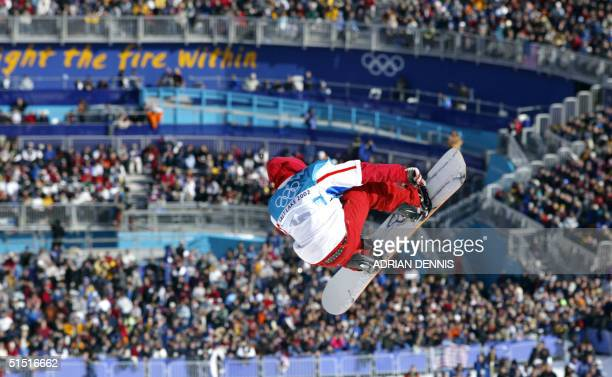 Mathieu Justafre of France goes airborne above the crowd during his qualifying run of the Men's Halfpipe snowboarding competition at the XIX Winter...