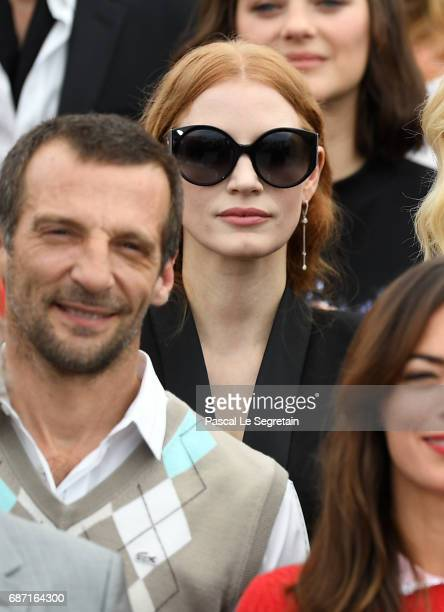 Mathieu Kassovitz and Jessica Chastain attend the 70th Anniversary Photocall during the 70th annual Cannes Film Festival at Palais des Festivals on...