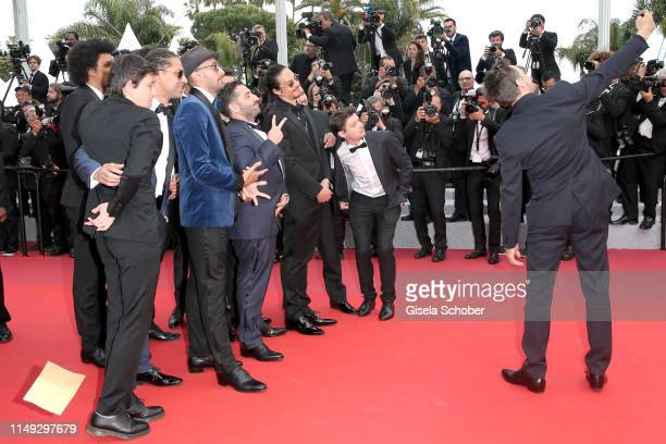 Mathieu Kassovitz takes a selfie with Jean Rene aka JR Mouloud Achour and other guests ahead the screening of Les Miserables during the 72nd annual...