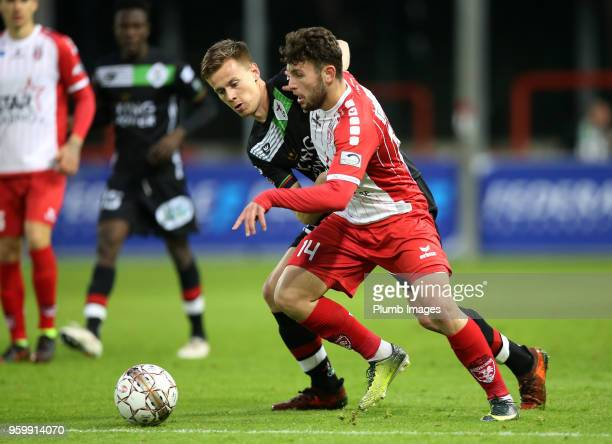 Mathieu Maertens of OH Leuven in action with Sebastjan Spahiu of Royal Excel Mouscron during the Belgian Playoff 2 tie between Royal Excel Mouscron...
