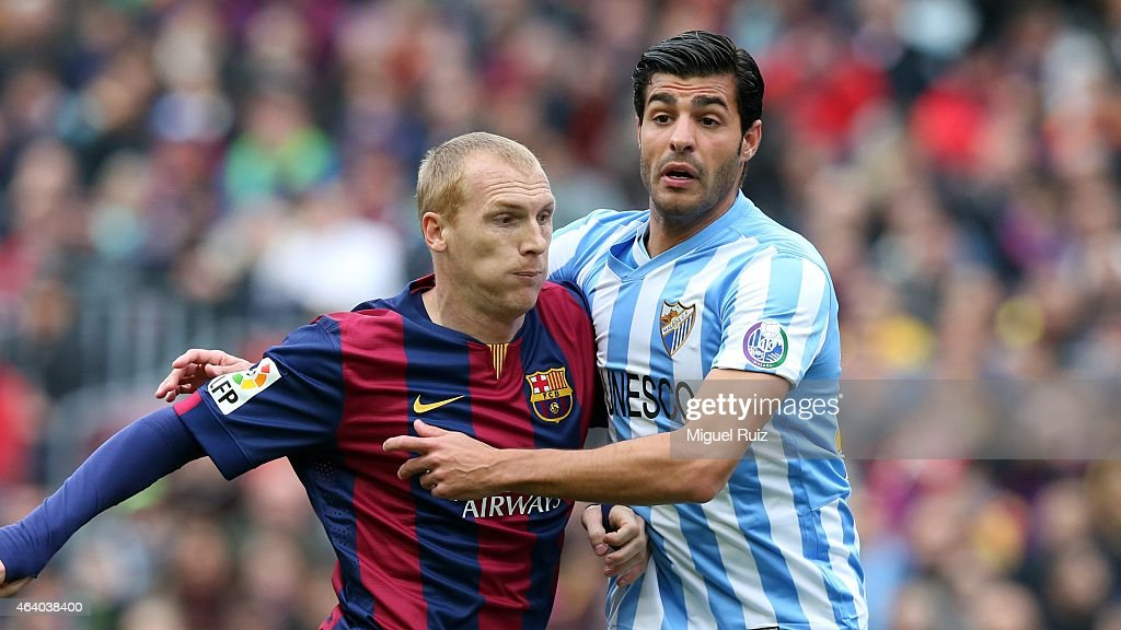 Mathieu of FC Barcelona competes for the ball with Miguel Torres of Malaga CF during the La Liga match between FC Barcelona and Malaga CF at Camp Nou on February 21, 2015 in Barcelona, Spain.