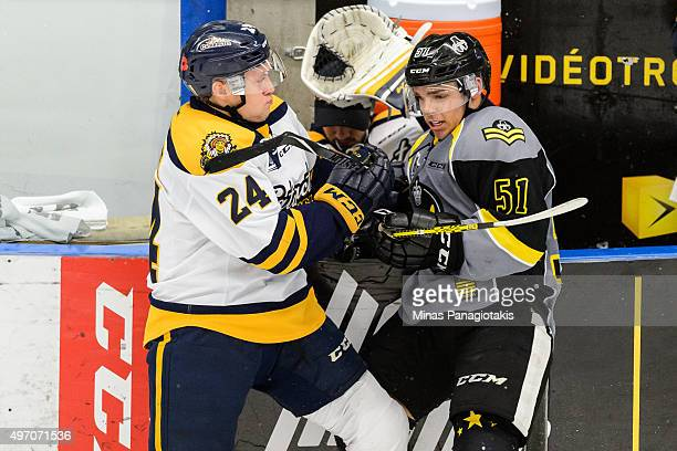 Mathieu Olivier of the Shawinigan Cataractes checks Charlie Roy of the Blainville-Boisbriand Armada during the QMJHL game at the Centre d'Excellence...