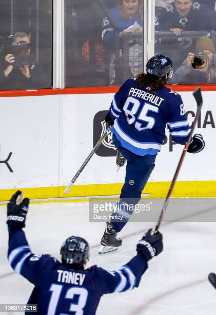 Mathieu Perreault and Brandon Tanev of the Winnipeg Jets react after a second period goal against the Vegas Golden Knights at the Bell MTS Place on...
