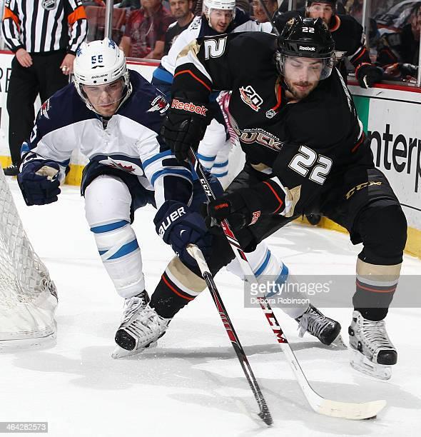 Mathieu Perreault of the Anaheim Ducks handles the puck against Mark Scheifele of the Winnipeg Jets on January 21 2014 at Honda Center in Anaheim...